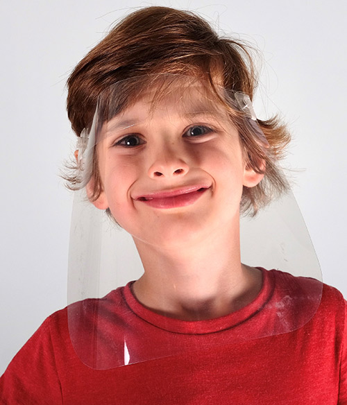 Smiling boy wearing VisorProtect Face Shield